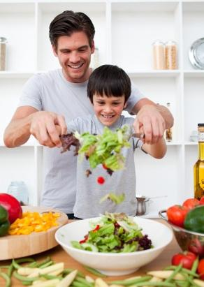 boy and father cooking