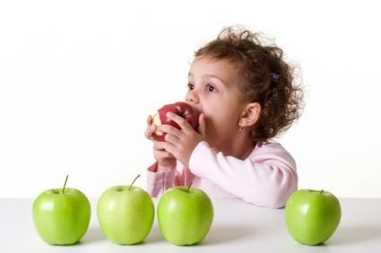 toddler eating an apple