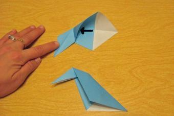 https://cf.ltkcdn.net/origami/images/slide/62699-693x462-Inside-Reverse%2C-Slide-2-with-Arrow.jpg