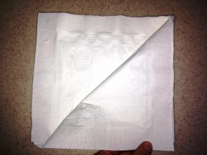 Folding napkin left to right corner
