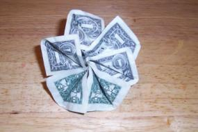 How to fold money into objects money origami origami money flowers source mightylinksfo