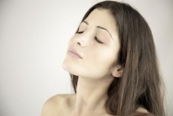 Woman relaxing with eyes closed