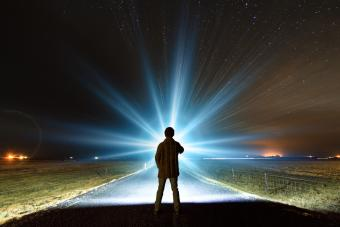 Figure looking at a mysterious light