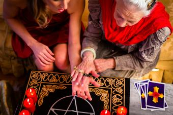 Soothsayer doing palmistry