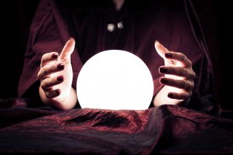 Clairvoyant doing reading with crystal ball