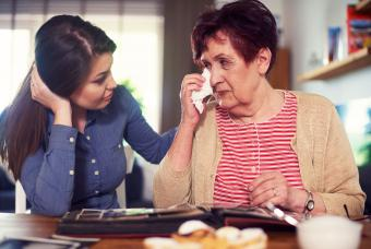 Young woman consoling senior woman