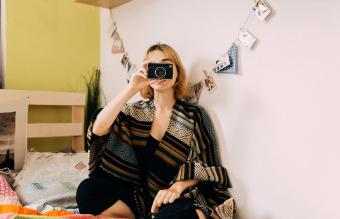 woman taking picture with instant camera