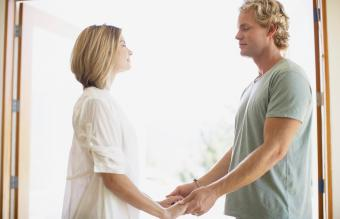 Couple holding hands at home