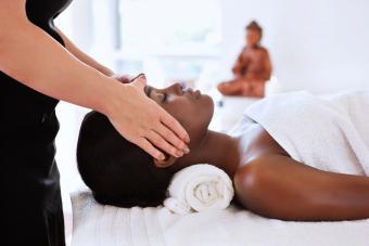 female masseuse giving a head massage