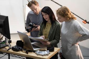 Team of people examining their photos