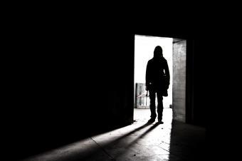 Man entering darkened room