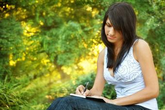Young woman writing in journal