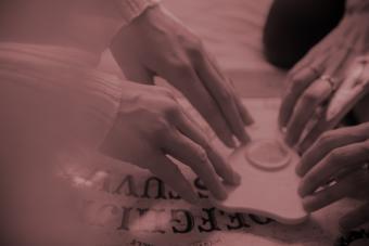 women using a Ouija board