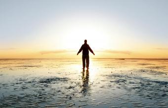 inspired man on beach