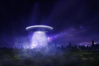 Spaceship over city at night