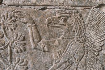 Ancient Assyrian limestone wall relief fragment of deity