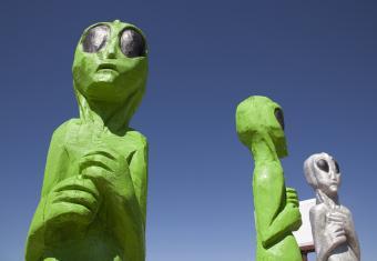 Wood carvings of green aliens