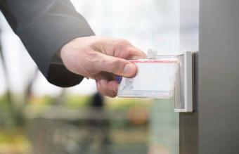 Businessman using access card