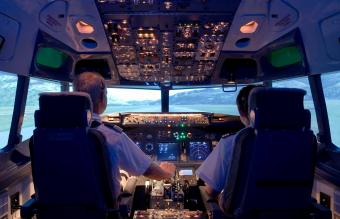 Pilots sitting in flight simulator