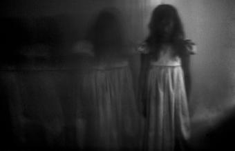 Spooky girl against wall