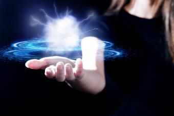 Woman's hand showing electricity ball