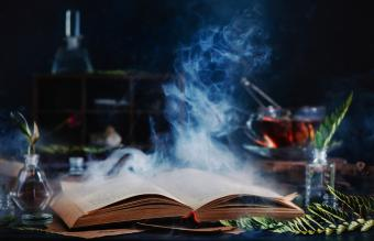 spell book with magical smoke