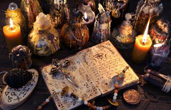 Ancient witch book with magic spell