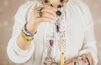 Woman using crystal pendulum