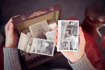 Senior woman discovering old photographs