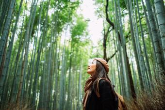 Young woman backpacker enjoying nature