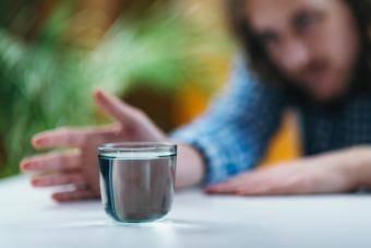 Practicing Telekinetic Powers with Glass of Water