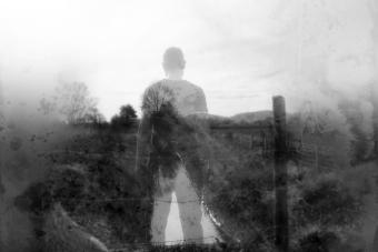 A winters day and a semi transparent male figure standing above