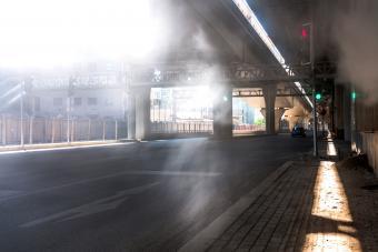 Asphalt road under the viaduct