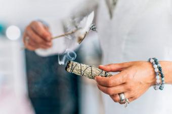 woman burning herbs