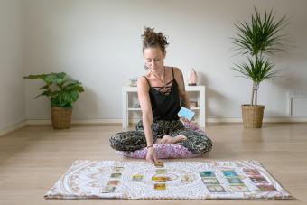 Woman reading tarot cards in spiritual room