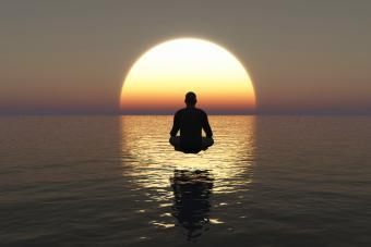 Young man sitting in deep meditation