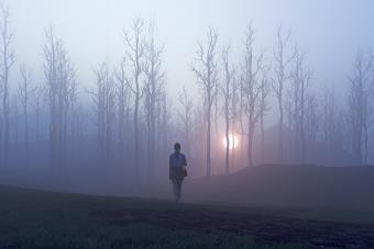 Woman walking towards mysterious light