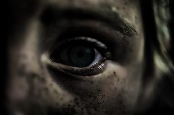 Scary girl with black eyes
