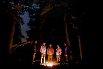 Group of friends around campfire