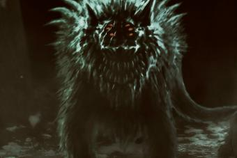 Demon wolf emerges from dark forest and opens his mouth