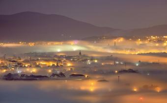 City night light in mist
