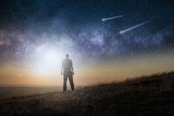 man looking at UFOs lights