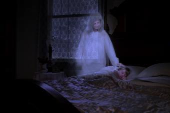 Ghost touching sleeping granddaughter