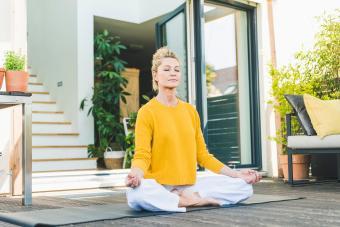 woman meditating on terrace
