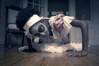 Voodoo Priestess crawling on the floor