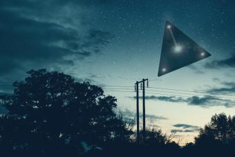 flying triangle floating above the countryside
