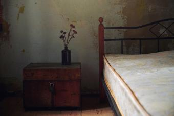 Vintage interior with bed and wooden trunk