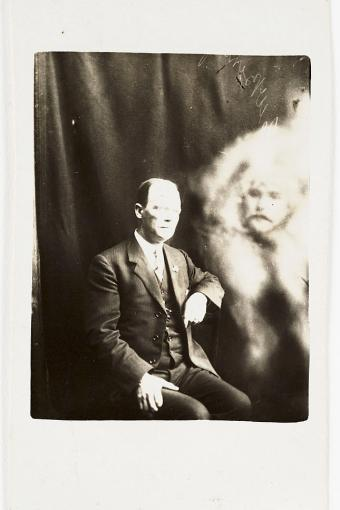 A man's blurred face appears next to the sitter, surrounded in an ethereal-looking 'mist'