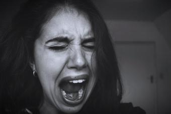 Close-Up Of Woman Shouting At Home