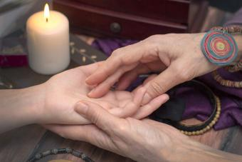 Psychic Medium reading woman's hand